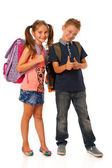 Choolboy and schoolgirl with schoolbags isolated over white back — Stock Photo