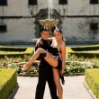 Beautiful young couple dancing outdoor in park — Stock Photo #65479131