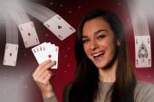 Beautiful caucasian woman with poker cards gambling in casino  — Foto de Stock