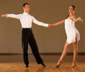 Latino dance couple in action - dancing wild samba  — Stock Photo