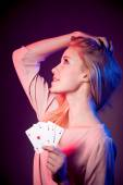 Beautiful caucasian woman with poker cards gambling in casino  — Stock Photo