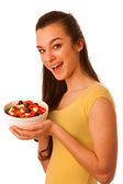 Beautiful asian caucasian woman with a white bowl of mixed salad — Stock Photo