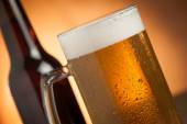 Big glass with handle filled with fresh beer with a lot of foam — Stock Photo