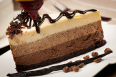 Chocolate and vanilla cake with chocolate syrup — Stock Photo