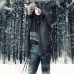 Young man wearing black fur hood winter jacket — Stock Photo #58409781