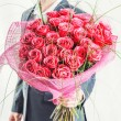 Man holding big bunch of red roses — Stock Photo #63557393
