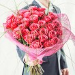 Man holding big bunch of red roses — Stock Photo #63557777