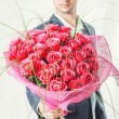 Man holding big bunch of red roses — Stock Photo #63557853
