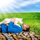 Husky dog puppy playing with happy man — Photo