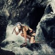 Adventure. woman with a knife in sea cave — Stock Photo #71192117