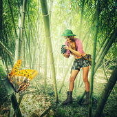 Woman with vintage camera in tropics — Stock Photo