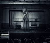 Ghost of actress on stage of old theater — Stock Photo