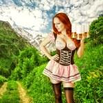 Bella donna sexy oktoberfest con tre tazze di birra — Foto Stock #81387670
