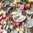 COLOGNE, GERMANY - AUGUST 26, 2014, Thousands of love locks which sweethearts lock to the Hohenzollern Bridge to symbolize their love on August 26 in Koln, Germany  — Stock Photo #52275755