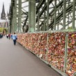 COLOGNE, GERMANY - AUGUST 26, 2014, Thousands of love locks which sweethearts lock to the Hohenzollern Bridge to symbolize their love on August 26 in Koln, Germany  — Stock Photo #52550963