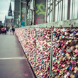 COLOGNE, GERMANY - AUGUST 26, 2014, Thousands of love locks which sweethearts lock to the Hohenzollern Bridge to symbolize their love on August 26 in Koln, Germany  — Stock Photo #52550973