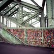 COLOGNE, GERMANY - AUGUST 26, 2014, Thousands of love locks which sweethearts lock to the Hohenzollern Bridge to symbolize their love on August 26 in Koln, Germany  — Stock Photo #52550983