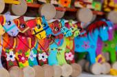 Wooden horses on a market stall — Stock Photo
