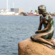 The Little Mermaid is a bronze statue by Edvard Eriksen, depicting a mermaid. The sculpture is displayed on a rock by the waterside at the Langelinie promenade in Copenhagen, Denmark — Stock Photo #53023147