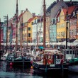 COPENHAGEN: Yacht in Copenhagen sea front in summer. Nyhavn is old waterfront and canal district — Stock Photo #53023157