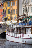 COPENHAGEN: Yacht in Copenhagen sea front in summer. Nyhavn is old waterfront and canal district  — Stock Photo