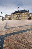 Castle Amalienborg with statue of Frederick V in Copenhagen, Denmark. The castle is the winter home of the Danish royal family  — Stock Photo