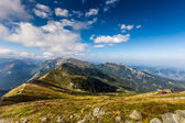 Path on the steep side of Kasprowy Wierch in Tatra mountains and a view of the border between Poland and Slovakia. — Stock Photo