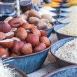 Different spices and herbs in metal bowls on a street market in India — Stock Photo