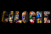 Word COLOGNE Stained glass church window — Stock Photo