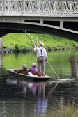 CHRISTCHURCH, NEW ZEALAND - NOVEMBER 08, 2014: A boatman guides a group of tourists in their punt down the Avon River on Easter Sunday afternoon on November 08, 2014 in Christchurch.  — Stock Photo