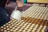 Candles and pot at Boudhanath stupa in Kathmandu, Nepal — Stock Photo