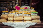 Traditional polish smoked cheese oscypek on outdoor market in Za — Stock Photo