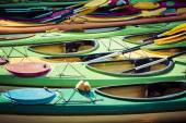 Colorful fiberglass kayaks tethered to a dock as seen from above — Stock Photo