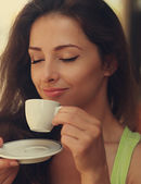 Beautiful happy woman drinking coffee with closed eye. Closeup vintage portrait — Stock Photo