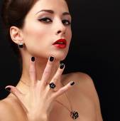 Beautiful fashion model with jewelry accessories and black fingernail looking sexy. Red lips makeup — Stock Photo