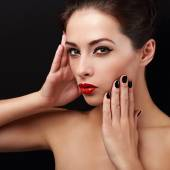 Sexy makeup woman with red lips and black finger nails posing — Stock Photo