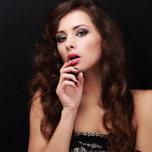 Sexy woman with erotic look holding finger near mouth — Stock Photo