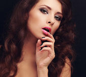 Beautiful makeup long hair woman looking sexy with finger — Stock Photo