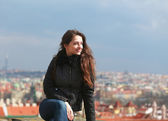 Beautiful woman looking happy on Prague europe city background — Stock Photo