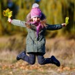 Little girl jamping with autumn leaves — Stock Photo #56081645