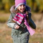 Little girl run in park. — Stock Photo #56081739