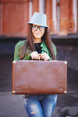 Portrait of a beautiful adult sensual woman with suitcase. — Stock Photo