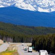 RV and buses on the road in Banff National Park — Stock Photo #66938837
