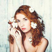 Beautiful girl with cotton plant — Stock Photo
