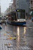 Tram going over garbage  — Stock Photo