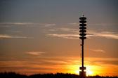 Tsunami warning tower at sunset — Stock Photo