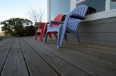 Garden chairs on a wooden deck — Stock Photo