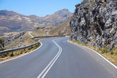 Winding road leading to the mountains in Greece — Stock Photo