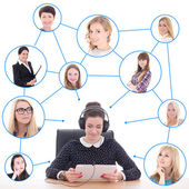 Young business woman with tablet pc and her friends or clients i — Stock Photo