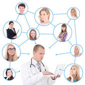 Social network concept - young male doctor with laptop and his p — Foto de Stock